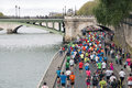 Marathon runners in paris by the riverside Royalty Free Stock Images