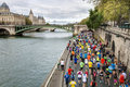 Marathon runners in paris by the riverside april Stock Photography