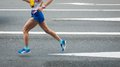 Marathon runners on the road motion blurred Stock Photos