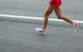 Marathon runners on the road motion blurred Stock Image