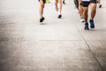 Marathon running race people competing in fitness and healthy ac active lifestyle feet on road Stock Images
