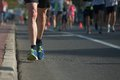 Marathon running race people competing in fitness and healthy active lifestyle feet on road Royalty Free Stock Photography
