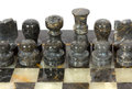 Marble chessmen on a chessboard black Stock Images