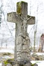 Marble cross on tomb at winter Royalty Free Stock Photo