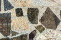 Marble and granite pieces random cemented together in a decorative pattern Stock Images