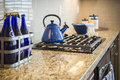 Marble Kitchen Counter and Stove With Cobalt Blue Decor Royalty Free Stock Photo