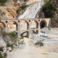 Marble quarry, bridge excavators. Carrara, Tuscany Stock Images