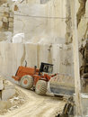Marble quarry excavators working for the transport of white cut into blocks Royalty Free Stock Photo