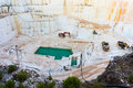 Marble quarry industrial pit in a mountain Royalty Free Stock Photos