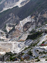 Marble quarry view with hairpin mountain road views italy industrial fantiscritti carrara Royalty Free Stock Image