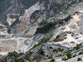 Marble quarry view with hairpin mountain road views italy industrial fantiscritti carrara Stock Photo