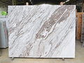 Marble slab supported by wooden frame on display in factory Royalty Free Stock Photo