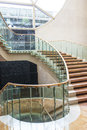 Marble staircase a luxurious winding with glass railing Stock Photo