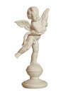 A marble statue of a little boy cupid with wings Stock Image