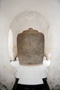 Marble stone slabs of buddhist cannon tripitaka texts one the incriptions originally in golden letters and borders at kuthodaw Royalty Free Stock Photography