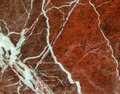 Marble texture with white veins, macro shot. Quality red marble. Marble stone backgrounds.