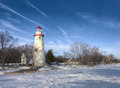 Marblehead lighthouse the historic in northwest ohio sits along the rocky shores of lake erie seen here from out on the frozen Stock Photos