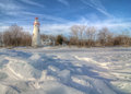 Marblehead lighthouse the historic in northwest ohio sits along the rocky shores of lake erie seen here from out on the frozen Royalty Free Stock Photo