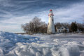 Marblehead lighthouse the historic in northwest ohio sits along the rocky shores of lake erie seen here from out on the frozen Stock Images