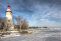 Marblehead lighthouse the historic in northwest ohio sits along the rocky shores of lake erie seen here from out on the frozen Royalty Free Stock Photos