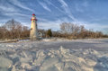 Marblehead lighthouse the historic in northwest ohio sits along the rocky shores of lake erie seen here from out on the frozen Stock Image