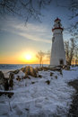 Marblehead lighthouse the historic in northwest ohio sits along the rocky shores of lake erie seen here at sunrise in winter with Royalty Free Stock Image