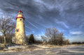Marblehead lighthouse the historic in northwest ohio sits along the rocky shores of lake erie seen here in winter with snow and Stock Photo