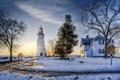 Marblehead lighthouse sunrise the historic in northwest ohio sits along the rocky shores of lake erie seen here at in winter with Royalty Free Stock Image