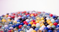 Marbles against white multicoloured fading into the distance a background Stock Photography