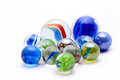Marbles with blue image of colours in them Royalty Free Stock Photography