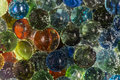 Marbles In Bubbly Soda Royalty Free Stock Photo