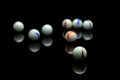 Marbles photo of color on black with reflection Stock Images