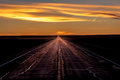 MARCH 8, 2017, NEBRASKA - Sunset over Rural Farm Country Road with pickup truck driving by row of powerlines Royalty Free Stock Photo