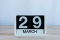 March 29th. Day 29 of month, everyday calendar on wooden table background. Spring time, empty space for text Royalty Free Stock Photo