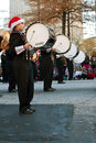 Marching band bass drummers perform in atlanta christmas parade ga usa december a high school bang their drums while perfomring Stock Photo
