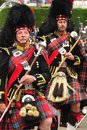 Marching drum majors braemar scotland two in full regalia at the royal highland games at Royalty Free Stock Photos