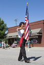 Marching with the us flag a young man marches at rathdrum days in rathdrum idaho on july Stock Images