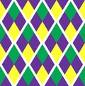 Mardi Gras abstract geometric pattern. Purple, yellow, green rhombus repeating texture. Endless background, wallpaper Royalty Free Stock Photo