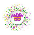 Mardi Gras abstract pattern made of colored dots on white background with colored clown mask in center.Yellow, green and purple co Royalty Free Stock Photo