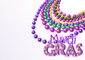 Mardi gras beads background with place for text Royalty Free Stock Photo