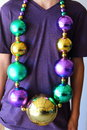 Mardi gras beads a close up view of someone wearing large for carnival Royalty Free Stock Photo