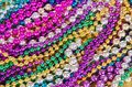 Mardi gras beads colorful background Stock Photos