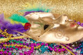 Mardi gras beads and mask colorful a golden Stock Image