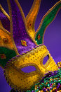 Mardi gras or carnivale mask on a purple backgroun festive grouping of venetian background Royalty Free Stock Photo