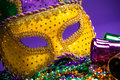 Mardi Gras or Carnivale mask on a purple background Royalty Free Stock Image