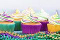 Mardi gras cupcakes and beads colorful Stock Photo