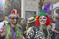 Mardi gras finery asheville north carolina usa march a man and woman wear costumes and colorful masks as they wave streamers and Stock Photos