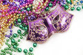 Mardi Gras mask and beads Royalty Free Stock Images