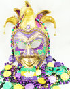 Mardi gras mask and beads with doubloons Stock Photo
