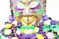Mardi gras mask and beads with doubloons Royalty Free Stock Image